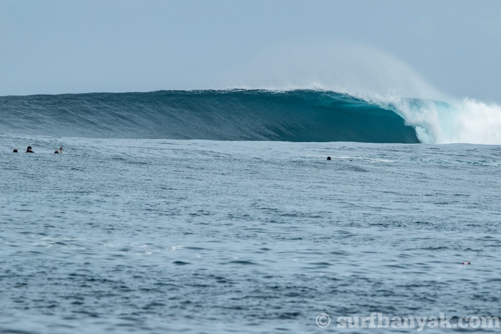 surfers are waiting for spilling wave, surf banyak