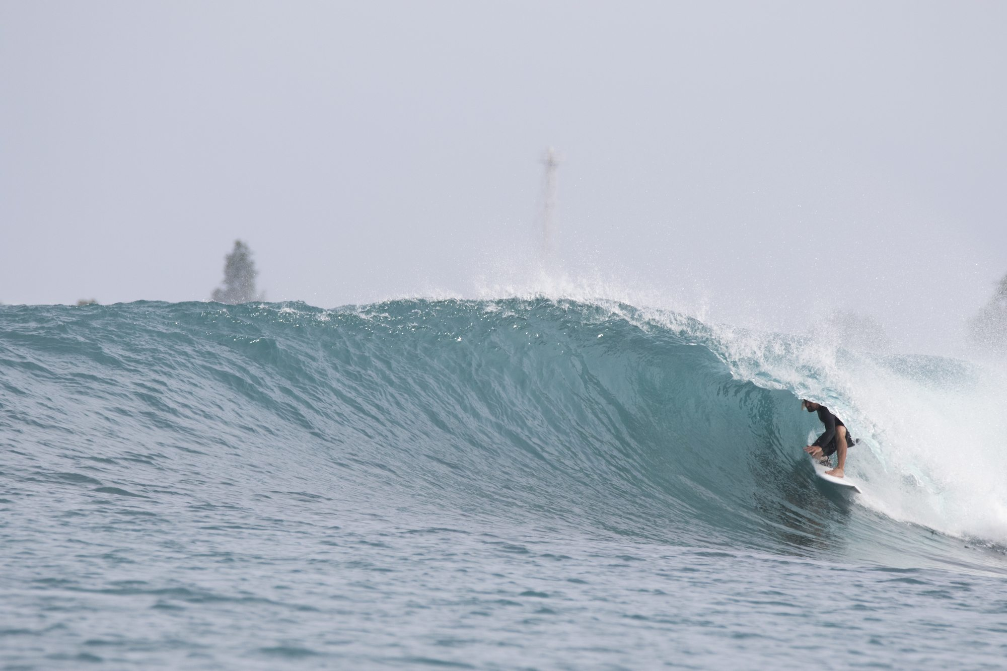 surfer in tiny hollow wave, surf banyak