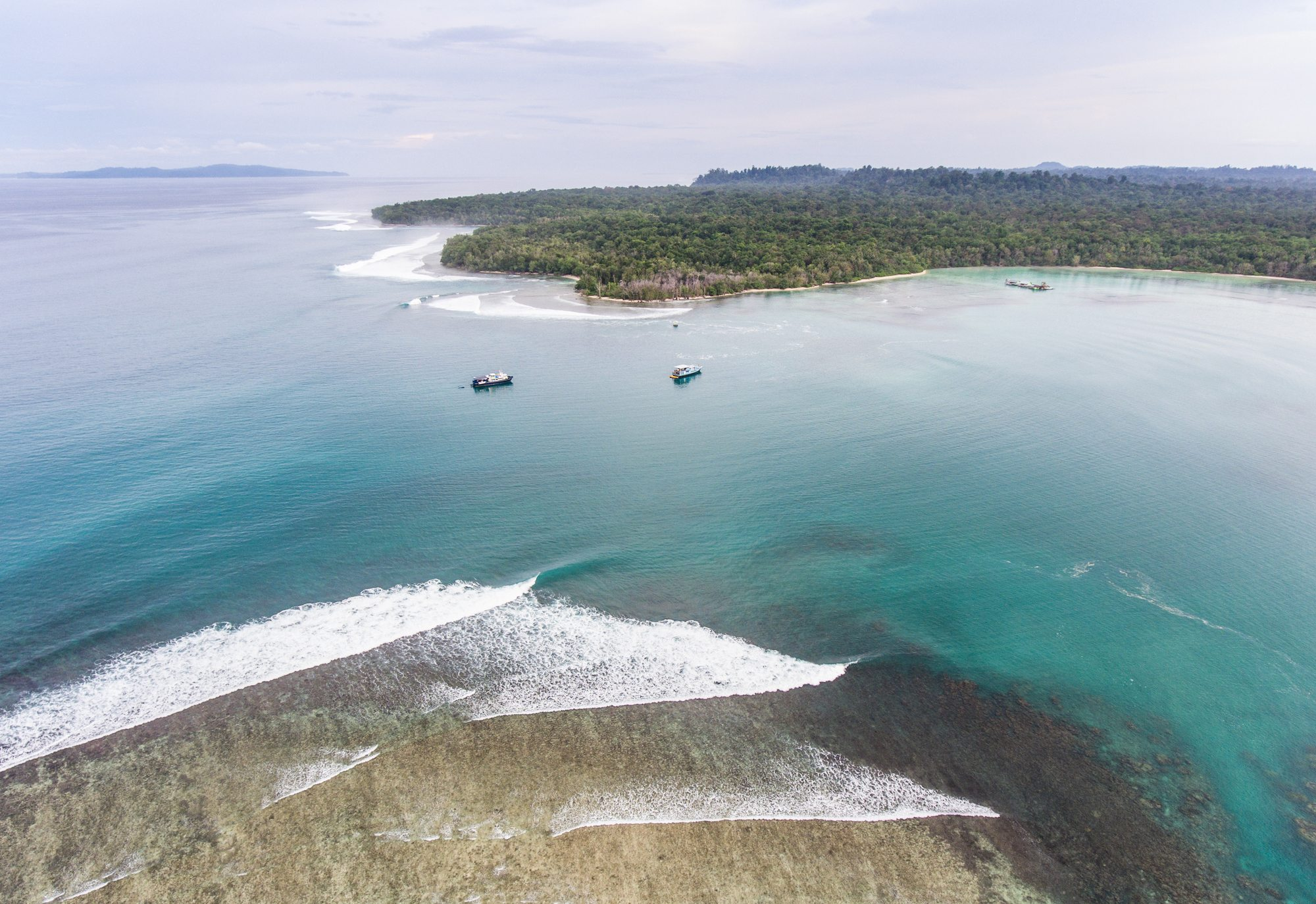 aerial view of rocky shore, surf banyak