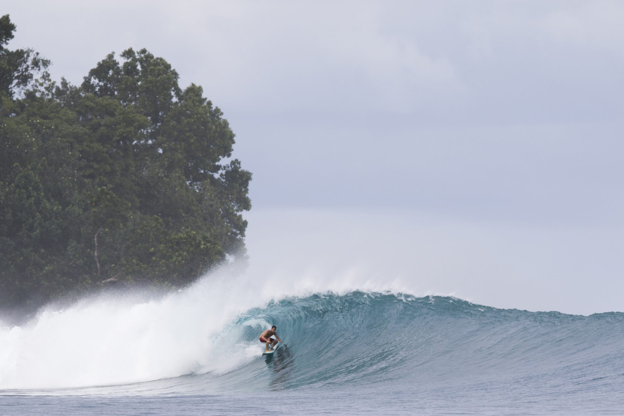 surfer in mini hollow wave, surf banyak