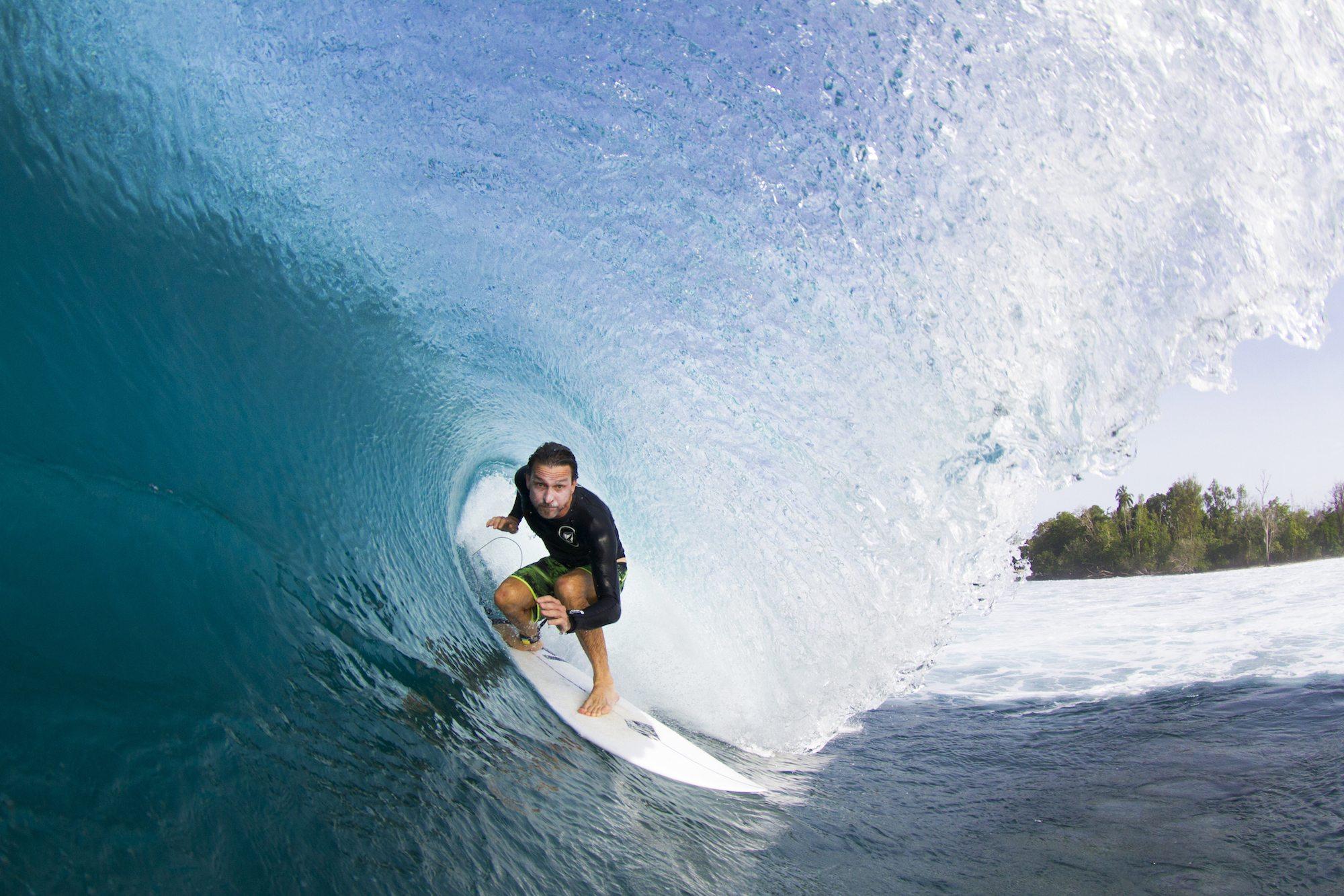 surfer is inside the barrel roll wave, surf banyak